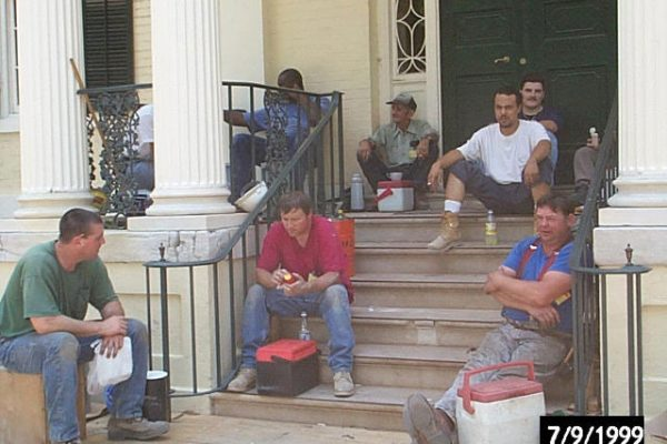 Construction workers on steps of West Portico